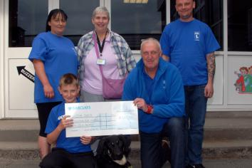 Lewis raises £1,465 for Guide Dogs NI