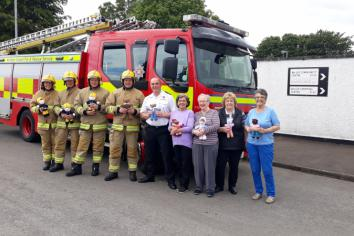 Ballee Knitting Club donate teddies to Fire Service