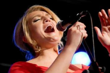 Amanda back in tune after tour cancellation