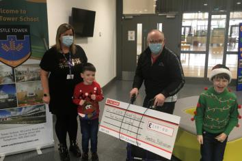 Castle Tower School receives £200 donation from Christian publishing house