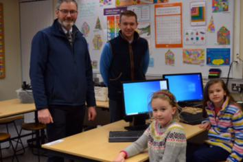 Cllr McCaughey gifts Kells and Connor Primary School newly refurbished computers